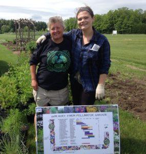 Sarah Salatino & Hannah Brill display the new garden design plan.